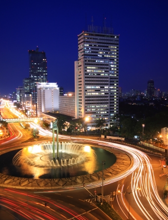 Night time view of traffic in the center of business district in Jakarta