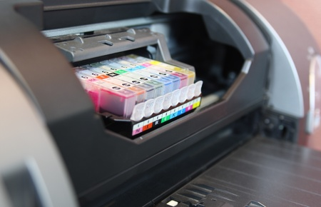 digital printing: inkjet printer  Close up on ink cartridges Stock Photo