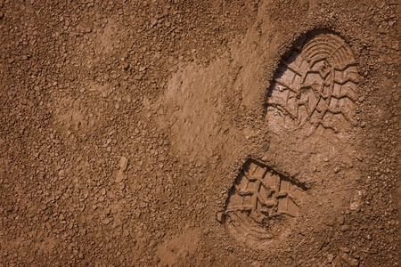 dirty feet: Imprint of the shoe on mud with copy space