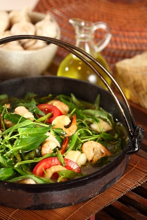 Delicious and healthy seafood water spinach served in a hot plate Stock Photo