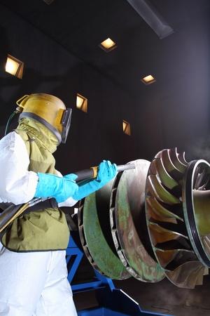 A worker working in a sandblast workshop Stock Photo - 13291424