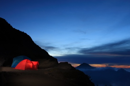 camp site in crater rim, on the way up Rinjani mountain. Stock Photo - 13615815
