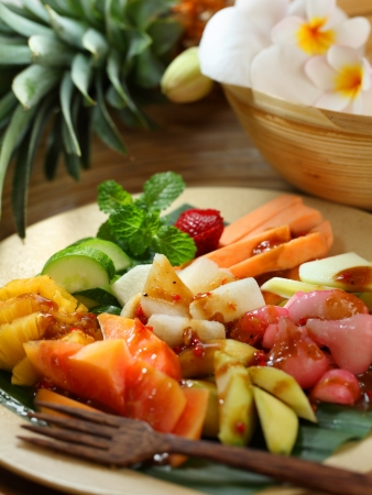 Rujak is a spicy fruit salad made with a  variable  mixture of fruits  The sauce is made by grinding together peanuts, palm sugar, tamarind, terasi  shrimp paste  and chilli