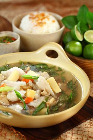 seafood soup: A bowl of Fish Seafood soup. A true treat for seafood lovers, this is more than just a soup. It's the main course and side dish all wrapped into one wonderfully flavorful meal in a bowl. Stock Photo