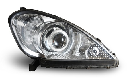 headlights: Modern car projector headlight isolated on white