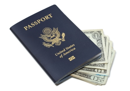 cash card: Passport of United States of America and Dollar bills isolated