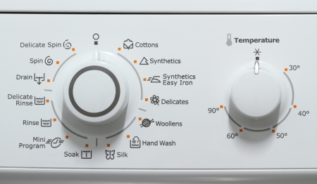 machine: Washing machine complex setting control dials Stock Photo