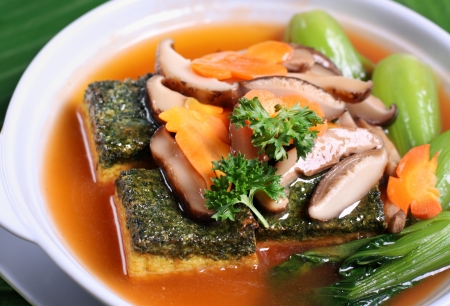Asian braised tofu and vegetable dish in claypot