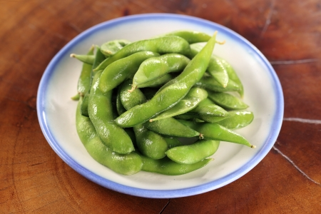 plate of boiled edamame or soybeans photo