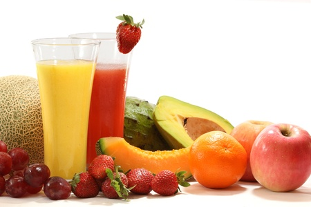 Healthy fruit juices with fresh fruits isolated on white