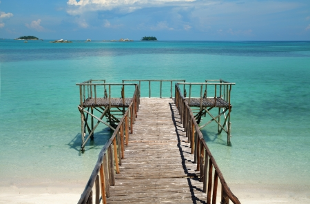 Pier on a tropical beach Stock Photo - 20309013