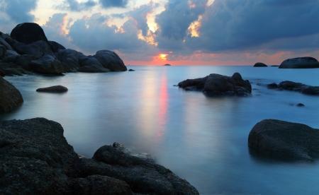 Dramatic sunset in rocky beach, Tanjung Pandan, Belitung, Indonesia  Long exposure shot
