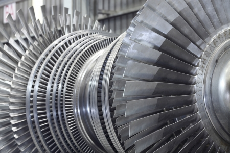 strong wind: Internal rotor of a steam Turbine at workshop Stock Photo