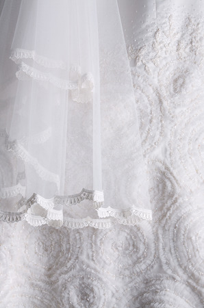close up detail of a white wedding gown