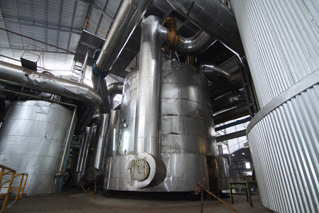 evaporator tanks in a sugar mill