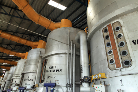 vacuum pan processing equipment in a modern sugar mill factory Stock Photo