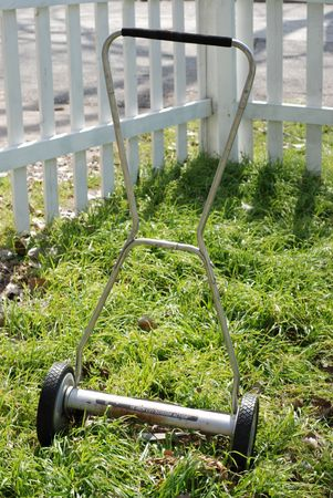 Old Hand Lawn Mower in Grass Stock Photo