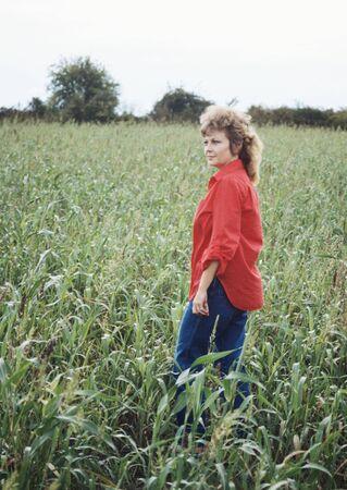 Beautiful Woman in Corn Field Stock Photo