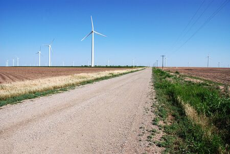 Wind Turbines along Country Road Stock Photo