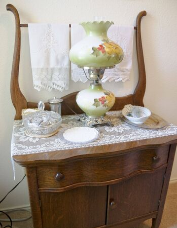 Close-up of antique dresser with antiques sitting on top of dresser