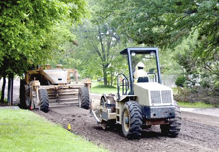 Two large road repair equipment in action