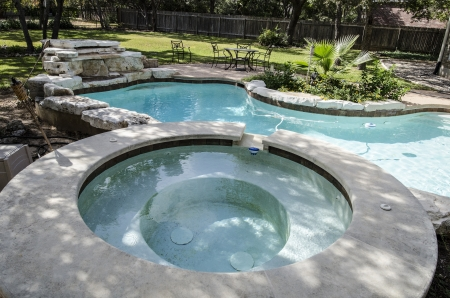 inground: Large Upscale hot tub attached to kidney shaped swimming pool