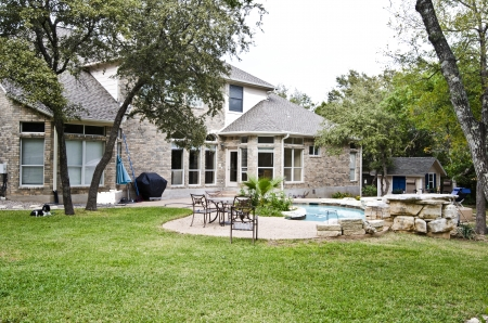 Rear view of an upscale house with swimming pool Stock Photo - 18559813
