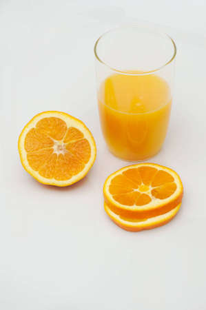 Orange with fresh juice on white background photo