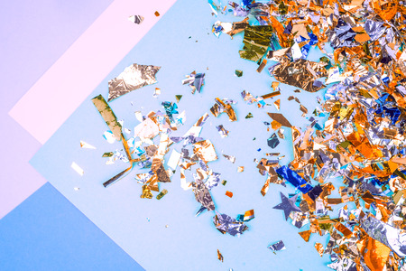 Colorful celebration background with confetti,stars, fireworks and decoration on blue background. Flat lay. Place for text. Reklamní fotografie - 122014025