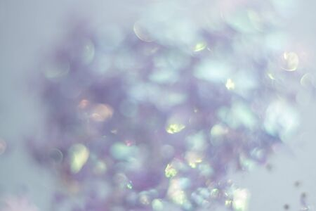 Abstract background of glitter and foil hologram, Glittering dust particles. Backdrop for your design. 免版税图像