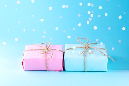 Two gift boxes of pink and blue. Place for text.