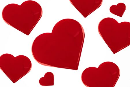 Many hearts of red nail polish on an isolated background.