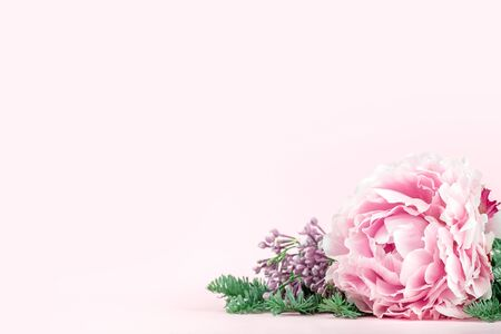 Very beautiful bouquet of flowers from peonies decorated with coniferous branches, winter-spring plants close-up. Holiday concept. Flowers for Mothers Day. Copy space. Reklamní fotografie