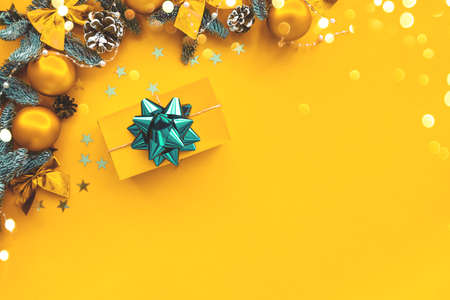 Christmas composition. Gold background with gift box and decorations. Stock fotó