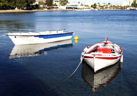 hollidays: two fishing boats with water reflections