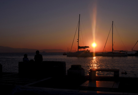 sunset in a greek island photo
