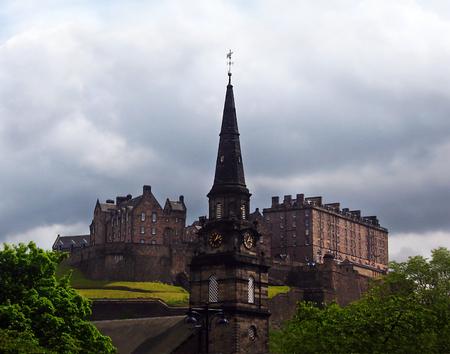 scott monument: clock tower in front of the castle of Edinburgh Scotland