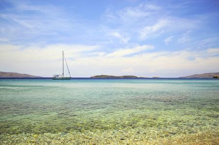 andros: a sailboat in Batsi beach Andros Greece