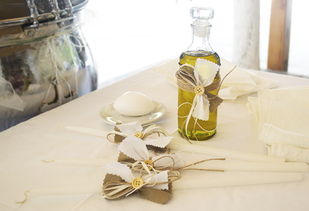 godfather: Orthodox Christening oil with candles Stock Photo