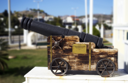 ajax: memorial cannon on Salamis town hall Greece