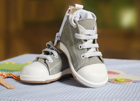 the godfather: baby boy christening shoes Stock Photo