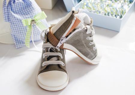 baptize: baby boy christening shoes Stock Photo