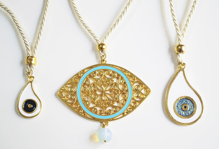 evil eye: expensive gold greek evil eye necklaces Stock Photo