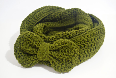 acrylic yarn: crochet green infinity scarf with big bow Stock Photo
