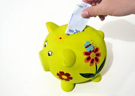 green pig money box, saving money concept