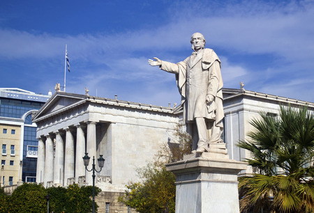 statue: man statue in front of the university of Athens Greece Editorial