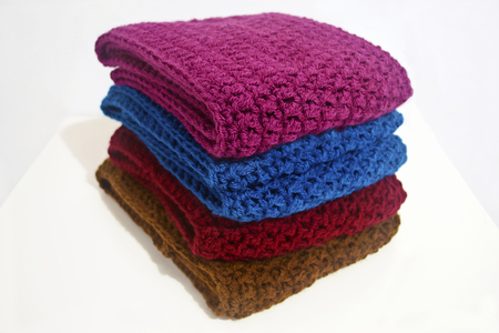acrylic yarn: crochet scarves in multiple colors Stock Photo