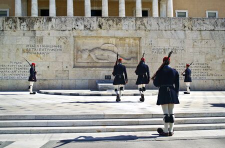 tsolias: ATHENS GREECE, JANUARY 12 2016: greek evzones, greek tsolias, guarding the presidential mansion in front of the tomb of the unknown soldier, army infantry. Editorial use.