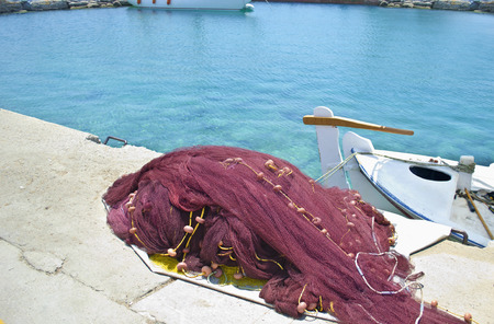 redes de pesca: greek island fishing nets and a boat - traditional greek seafood