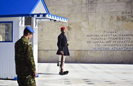 tsolias: ATHENS GREECE, JANUARY 23 2016: soldier oversees the evzones in Athens Greece, guarding the presidential mansion in front of the tomb of the unknown soldier. Editorial use. Editorial